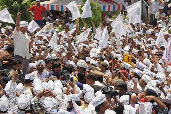 AAP convener Arvind Kejriwal with supporters during a road show on the way to file his nomination papers in Varanasi.