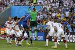 Germany's goalkeeper Manuel Neuer, center, saves a corner kick during the World Cup final match between Germany and Argentina at the Maracana Stadium in Rio de Janeiro, Brazil.