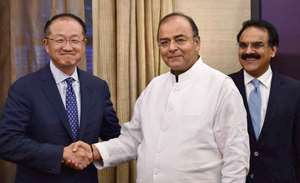 Finance Minister Arun Jaitley greets World Bank President Jim Yong Kim during a meeting at North Block in New Delhi. Finance Secretary Arvind Mayaram (R) is also seen.