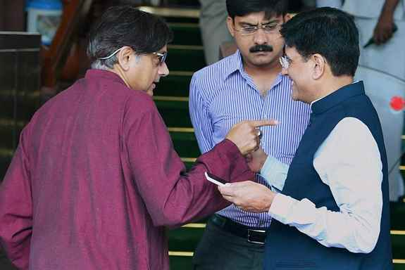 Power and Coal Minister Piyush Goyal with Congress MP Shashi Tharoor at Parliament.