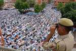 A security person keeps vigil as Muslims offering Jumat-ul-Vida prayers at Badi Chaupad near Jama Masjid in Jaipur.