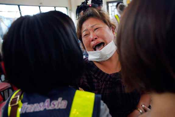 A relative of a victim in the TransAsia Airways flight GE222 crash cries during a funeral service on the Taiwan island of Penghu. Stormy weather on the trailing edge of Typhoon Matmo was the likely cause of the plane crash that killed more than 40 people.