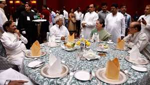 Congress President Sonia Gandhi with RJD chief Lalu Yadav, JD(U) chief Sharad Yadav and NCP leader Tariq Anwar (R) during her Iftar party in New Delhi.