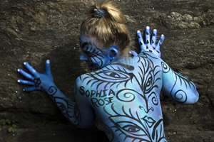 Body-painting artists gathered to decorate nude models at Columbus Circle as part of an event featuring artist Andy Golub, in New York.