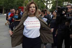 Valerie Trierweiler, former companion of French President Francois Hollande and head of the Association Bring Back Our Girls, displays her T-shirt reading Bring Back Our Girls, Secure the paths to School, during the inauguration of a creation, symbolizing the hundreds of girls abducted from the Government Secondary School in Chibok, Nigeria, at Place de la Republique in Paris, France. Islamic extremists were responsible for the kidnapping.
