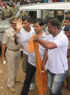 Police take top Maoist leader Sabyasachi Panda while taking him to court in Berhampur.