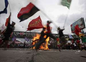 Protesters dance around the burning effigy of Philippine President Benigno Aquino III during a rally near the House of Representatives to coincide with his State of the Nation Address at suburban Quezon city, northeast of Manila, Philippines. Aquino is expected to tackle in his address, the controversial Disbursement Acceleration Program, the allocation of funds or savings by the Government to finance various programs or projects which is under the discretion of the president and was declared in part as unconstitutional by the Supreme Court.
