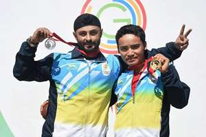 India's Jitu Rai and Gurpal celebrate after winning gold and silver medals respectively in the 50m Pistol event during the Commonwealth Games at Barry Buddon Shooting Centre in Glasgow, Scotland.