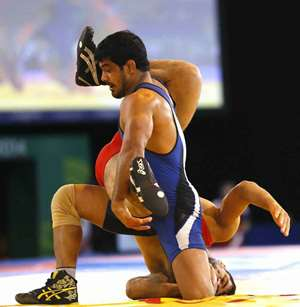 Sushil Kumar of India, front, wrestles with Qamar Abbas of Pakistan in a FS 74kg gold medal wrestling match at the Scottish Exhibition Conference Centre during the Commonwealth Games 2014 in Glasgow, Scotland.
