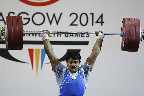 Chandrakant Dadu Mali of India lifts188kg to win bronze in the Men's 94kg weightlifting competition at the Scottish Exhibition Conference Centre during the Commonwealth Games 2014 in Glasgow, Scotland3