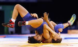 Vinesh of India, left, wrestles with Yana Rattigan of England in the FS 48kg gold medal wrestling match at the Scottish Exhibition Conference Centre during the Commonwealth Games 2014 in Glasgow, Scotland, Tuesday July 29, 2014. (AP Photo/Kirsty Wigglesworth). Vinesh won 11-8