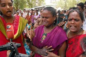 Victims along with family members of  Kumbakonam school fire tragedy react to judgement at the premises of Tanjavur district court after the judgement, over a decade after a devastating fire charred to death 94 school children, a local court today convicted 10 persons and acquitted 11 others in the ghastly school fire tragedy in Kumbakonam.