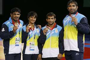 India's wrestling medalists Sushil Kumar, left with gold, Vinesh, second left with gold, Amit Kumar, second right with gold and Rajeev Tomar, right, with silver pose with their medals at the Scottish Exhibition Conference Centre during the Commonwealth Games 2014 in Glasgow, Scotland, Tuesday July 29, 2014.
