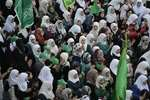 Hamas supporters shout slogans against Israeli military action in Gaza, during a demonstration in the West Bank city of Nablus.