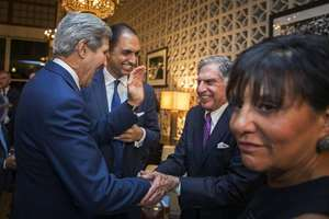 U.S. Secretary of State John Kerry greets Ratan Tata with U.S. Secretary of Commerce, Penny Pritzker, right, before a dinner at the U.S. Ambassador's residence in New Delhi.