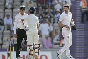 England's James Anderson and India's Ajinkya Rahane leave the field at the end of play on the fourth day of the third cricket test match of the series between England and India at The Ageas Bowl in Southampton, England.
