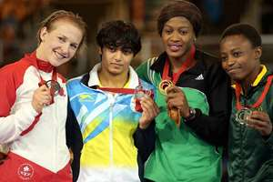 India's silver medalist Lalita, Nigeria's Gold Medalist Odunayo Adekuoroye, South Africa's Bronze medalist Mpho Madi and Canada's bronze medalist Jill Gallays after the medal ceremony of women's Freestyle Wrestling 53kg final match at the Scottish Exhibition Conference Centre during the Commonwealth Games 2014 in Glasgow, Scotland.