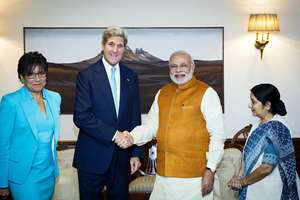 U.S. Secretary of State John Kerry with Prime Minister Narendra Modi, as Foreign Minister Sushma Swaraj and U.S. Secretary of Commerce Penny Pritzker stand by their sides at Modi's residence in New Delhi.