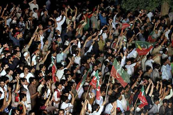 Supporters of Pakistani cricketer-turned-politician Imran Khan chant slogans during a protest in Islamabad. Khan on Monday announced to lead thousands of anti-government protesters into the high security 'Red Zone' as his 48 hours deadline for government to step down ending Tuesday.