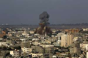 Smoke and debris rise after an Israeli strike hit Gaza City in the northern Gaza Strip.