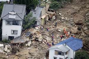 Rescue workers search for survivors after a massive landslide swept through residential areas in Hiroshima, western Japan.