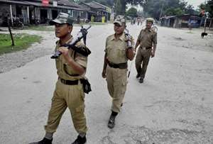 Security personnel patrolling a street during the 24-hr Assam Bandh called by National Democratic Front of Bodoland in a protest against the killing of 5 NDFB cadets in Chirang district.