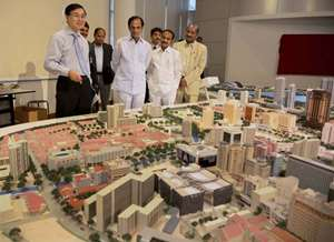 Telangana CM K Chandrasekhar Rao having a look of a model of Urban Planning Excellence in Singapore.