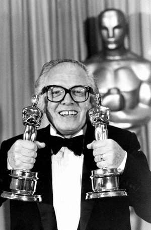In this April 11, 1983 photo, British actor and director Richard Attenborough holds his two Oscars for his epic movie <i>Gandhi</i> at the 55th annual Academy Awards in Los Angeles, California. Attenborough, whose film career on both sides of the camera spanned 60 years, died on August 24, 2014. He was 90.