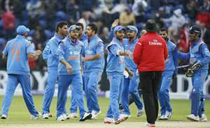 India's Suresh Raina, third left, celebrates with his teammates after they defeated England in their One Day International cricket match at the SWALEC cricket ground in Cardiff, Wales.