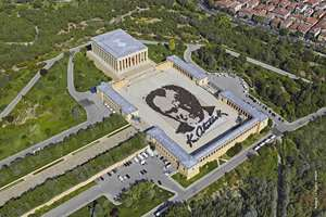 In this aerial photo made available by the Turkish Military, some 6,000 people form a large portrait of Mustafa Kemal Ataturk, the founder of modern Turkey at his mausoleum in Ankara, Turkey.