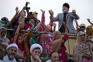 Pakistan's Tahir-ul-Qadri addresses his supporters during an anti-government sit-in protest near the parliament building in Islamabad.
