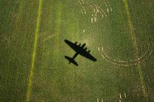 The World War II B-17 bomber, Sentimental Journey, flies over fields outside of Culpeper, Va. The plane will be available for cockpit tours and flights at Culpeper Regional Airport. (