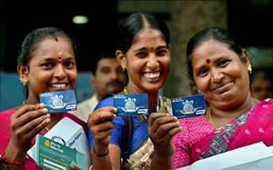 Women beneficiaries displaying the ATM/Debit cards after receiving it from Union Minister for Law and Justice, Communications and Information Technology, Ravi Shankar Prasad during the launch of 'Pradhan Mantri Jan Dhan Yojana' in Chennai.