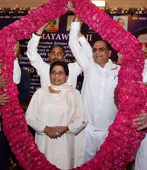 Mayawati is garlanded after she was unanimously elected as the National President of BSP for the third term in Lucknow.