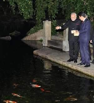 MEA tweets: Feeding the fish. PM @narendramodi & PM @AbeShinzo began engagement in Kyoto following tradition of feeding the fish.