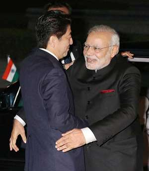Prime Minister Narendra Modi is welcomed by his Japanese counterpart  Shinzo Abe  upon arrival at State Guest House in Kyoto.
