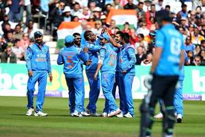Mohammed Shami celebrates running out England's Ian Bell during their One Day International cricket match at the Trent Bridge cricket ground in Nottingham.
