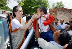 Congress president with a child during a visit to her constituency Rae Bareli.