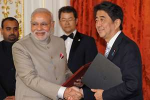 Prime Minister Narendra Modi, left, shakes hands with Japanese Prime Minister Shinzo Abe during a signing ceremony at Akasaka State Guesthouse in Tokyo.