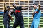 Olympic gold medalist sprinter Usain Bolt in his trademark pose with cricketers Yuvraj Singh and Harbhajan Singh in the sidelines of a friendly cricket match in Bengaluru.