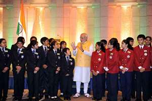 Prime Minister Narendra Modi interacts with children at a reception held by the Indian community in Tokyo, Japan.