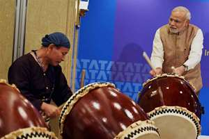Prime Minister Narendra Modi beating a traditional Taiko drum during inauguration of the Tata Consultancy Services (TCS) Japan Technology and Culture Academy in Tokyo.