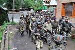Security personnel during an encounter with LeT militants in Hanjan village in Rajpora area of Pulwama.