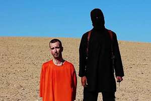 This image made from video posted on the Internet by Islamic State militants and provided by the SITE Intelligence Group, a U.S. terrorism watchdog, purports to show British aid worker David Haines before he was beheaded. The video emerged hours after the family of Haines issued a public plea urging his captors to contact them. The 44-year-old Haines was abducted in Syria in 2013 while working for an international aid agency.