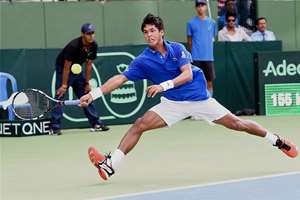 Somdev Devvarman in action against Serbia's Dusan Lajovic during the 1st reverse singles match of World Group play off tie at KSLTA Stadium in Bengaluru. Somdev won 1-6, 6-4, 4-6, 6-4, 6-3.