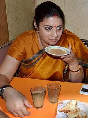Human Resource Development Minister Smriti Zubin Irani sips tea in a saucer at a tea stall in Amritsar.