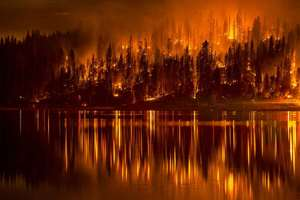 A fire approaches the shore of Bass Lake, Calif.
