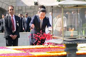 Chinese President, Mr. Xi Jinping paying floral tributes at the Samadhi of Mahatma Gandhi, at Rajghat, in Delhi.