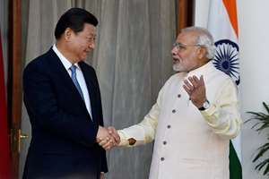 Prime Minister Narendra Modi and Chinese President Xi Jinping shake hands during a meeting at Hyderabad House, in New Delhi.