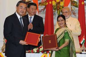 Prime Minister, Narendra Modi and the Chinese President, Xi Jinping witnessing the signing of an MoU between the Ministry of External Affairs Minister, Sushma Swaraj and Minister of Foreign Affairs of the People's Republic of China, Wang Yi on opening a New Route for Indian Pilgrimage (Kailash Mansarovar Yatra) to the Tibet Autonomous Region of the People's Republic of China, in New Delhi.